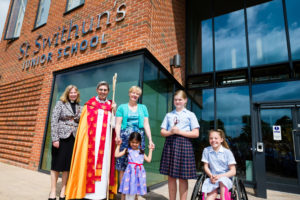 Rev'd Katrina Dykes (St Swithun's School Chaplain), The Right Reverend Tim Dakin, Bishop of Winchester, Pim Grimes (Headmistress of St Swithun's Junior School), Amari (youngest pupil), Evie (head girl) and Zara (oldest pupil)
