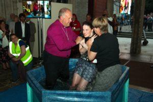 Bishop David baptising Holly Catto