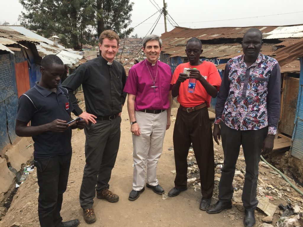 Bishop Tim and Canon Principal Mark Collinson with students from the Centre for Urban Mission, Kibera